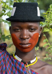 Beautiful young woman with a hat and some make up during the fat men ceremony in the Bodi tribe, Omo valley, Hana Mursi, Ethiopia (Eric Lafforgue) Tags: 20s abyssinia adult africa beautifulwoman beauty bodi ceremony closeup culture day eastafrica ethiopia ethiopia0617648 ethiopian ethiopianethnicity ethnology fashion female feminine festival hanamursi hat headshot hornofafrica humanface kael lookingatcamera makeup omovalley onepersononly onewomanonly outdoors portrait realpeople southernethiopia traditionalclothing tribal tribe tribeswoman vertical woman youthculture et
