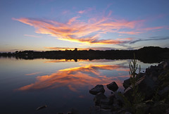 Swirling Flames (Tiara Rae Photography) Tags: swirling flames clouds sunset sky mirrored mirror reflection lake water rocks landscape nebraska omaha zorinsky
