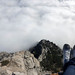 Sitting on the edge of the mountain with feet over an abyss. Ai-Petri mountain, Crimea