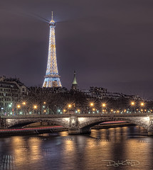 Eiffel Tower Glowing [Explored] (DiGitALGoLD) Tags: bridge paris france tower water seine night lens nikon long exposure shot eiffel flare glowing nikkor bp f28 baton d3 mouche 2470mm baladesparisiennes frbloodypix