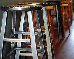 A cold beer on a hot day...the stools at the Only Cafe, Danforth, Toronto (Sally E J Hunter) Tags: toronto danforth stools theonly moo1 35mmf18 onlycafe theonlycafe