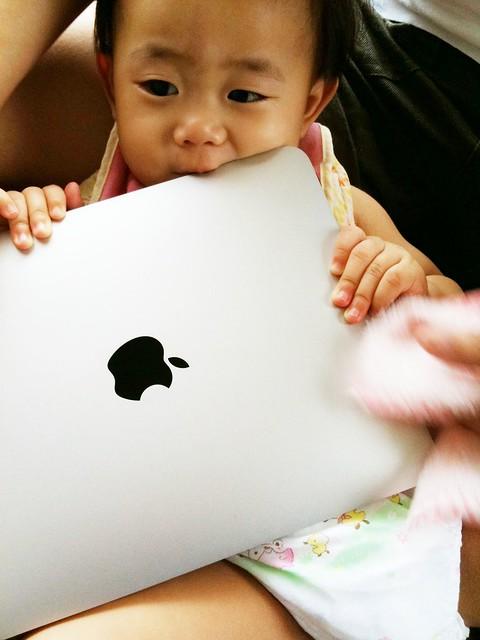 baby eating iPad