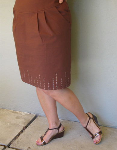 Brown skirt pleats