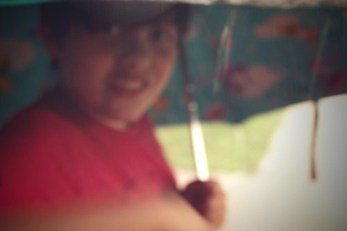 my son, hogging the umbrella