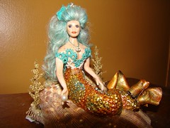 Selena by Whispering Eagle, skylereagle.777@gmail.com, who sculpted the tail on my mermaid...not the head/torso (which is Crystal by Doreen Sinnet) and the arms are a mold by Cynthia Howe.
