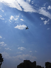 Plane Under Rays of Light (iFadey) Tags: blue pakistan light sky reflection silhouette clouds plane army hassan rays pak islamabad fawad ifadey