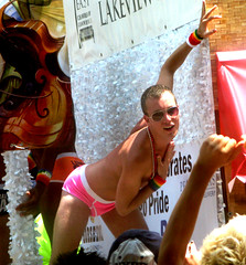 2010 Chicago Pride Parade (tacosnachosburritos) Tags: street city gay boy people urban dog chicago cup festival lesbian naked nude penis happy town justice rainbow shiny suits breast tits dancers cross dancing body spin hard patrick pride flags confetti parade celebration governor bikini stanley topless satan quinn devil homosexual superheroes collar bodysuit dresser undies festivities bodies league floats bozo roscoes gladiator tighty whities boystown thecup sopel extroverts blackhwaks