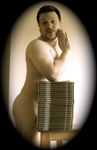 Flickr image: A black and white faux-1920s image of Remy naked, with his gentlemanly appendage obscured by a stack of 25 copies of Introducing HTML5