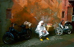 Man and a Bike (Andrew Clarey) Tags: africa man colors yellow sadness shoes sad vibrant north motorbike morocco marrakech
