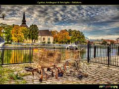 Kundvagnar, Cyklar & Fors kyrka (foje64) Tags: autumn reflection church bicycle can