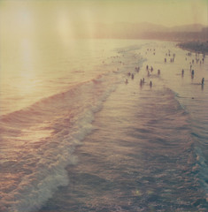 Awash (roostercoupon) Tags: ocean california ca venice light sunset sea color film beach water analog vintage print polaroid sx70 la pier losangeles surf waves pacific streak artistic integral flare instant expired tz atz impossibleproject edgecut