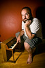 202/365 - Waiting for inspiration (Micah Taylor) Tags: red portrait man feet wall self toy chair floor little bare fat piano thoughtful hardwood project365