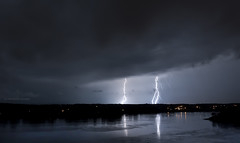 lightning 4 (marianna_a.) Tags: city light sky panorama cloud lake canada storm reflection nature water rain night river landscape horizon strike lightning thunder fury jmultiple