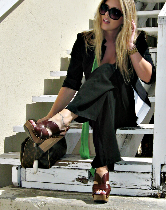 old steps+white stairs+miu miu clog sandals+louis vuitton bag+black and white outfit+green scarf+big black sunglasses