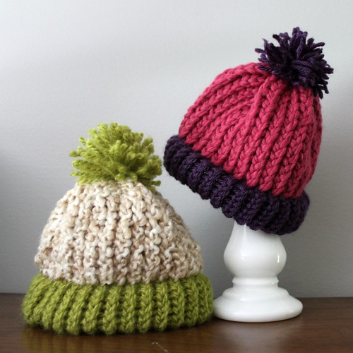 pair of acorn pom caps by you.