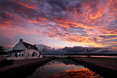 Caledonian Canal - Clachnaharry (freeskiing) Tags: sunset sea summer reflection clouds scotland july calm explore bigsky lockgates inverness gloaming dramaticcloud beaulyfirth highlandsofscotland keeperscottage caledonaincanal ndgrad03 benthorburn