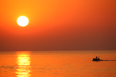 (ssj_george) Tags: morning sea orange sun reflection men water silhouette yellow sunrise canon lens eos rebel boat is fishing kiss waves fishermen cyprus f xs efs meditteranean kibris protaras f456 paralimni 55250 pernera 55250mm  georgestavrinos 1000d  ssjgeorge
