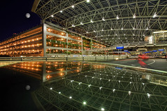 Reflection at Portland International Airport - HDR (David Gn Photography) Tags: longexposure travel moon reflection architecture night lights parkinggarage pickup structure passengers covered pdx lighttrails arrival departure flights hdr loading publicparking skywalk unloading portlandinternationalairport platinumheartaward canoneos7d sigma1020mmf35exdchsm sigma50th