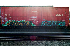(everkamp) Tags: seattle railroad graffiti washington trains lensflare sunrays decor freight boxcars ihp sry catalyst combos rollingstock railart benching