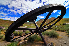 Big Wheel in Bodie (Bill Gracey) Tags: california sky color wheel clouds rust scenery colorful iron steel scenic ghosttown bodie bigwheel miningtown miningequipment abigfave californiastatehistoricpark platinumheartaward bodiemountains