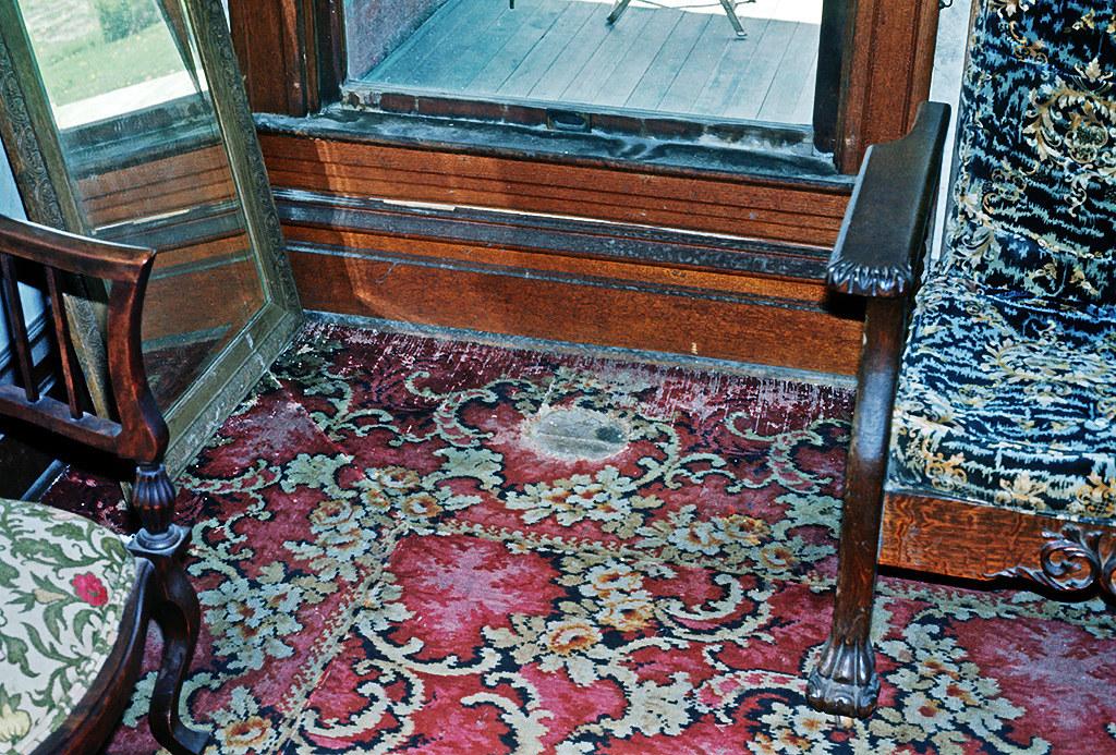 Voorhies Castle - Hole In Carpet Caused by Flower Urn At Head of Casket
