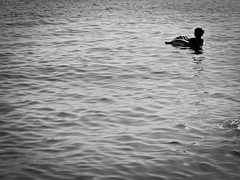 In the sea (Richard Holden) Tags: sea blackandwhite holiday spain andalucia sally inflatable almerimar dalias lumixgvario1445f3556 panasonicdmcgf1