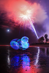 Hooper (shadinsb) Tags: california longexposure moon lightpainting beach water reflections palms fun fireworks ooh excitement countyfair hooping hooper ventura aah huluhoop hoophabit