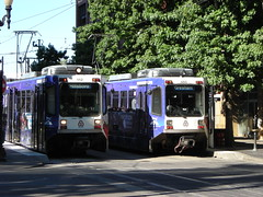 Two purple Bombardier cars just west of the Steel Bridge