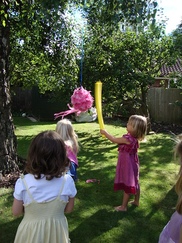 Pink piñata whacking fun