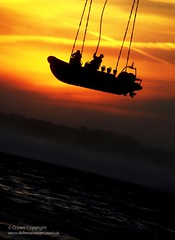 A Royal Marines Boat is Lifted by a Chinook Helicopter (Defence Images) Tags: uk sunset training sunrise boat military free competition inflatable hanging trophy british suspended defense defence poole peregrine royalnavy rigid royalmarines rigidraiders underslinging