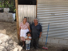 Berta y Enrique and Hemenia infront of the home