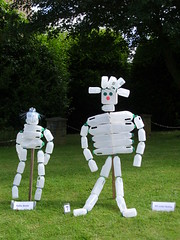 Bottle scarecrows (Nekoglyph) Tags: appletonwiske yorkshire village scarecrow festival 2017 summer milk bottles plastic white empty recycling figures green blue red grass hedges trees