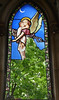 An angel carries a child to Heaven - stained glass window (Monceau) Tags: angel carrying child heaven stainedglass window broken trees cimetièredumontmartre