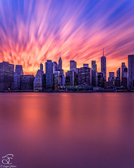 Why Portrait? (BeNowMeHere) Tags: ifttt 500px sky city sunset color water downtown reflection travel urban architecture cityscape building evening skyline skyscraper dawn modern panoramic trip colorful waterfront illuminated dusk landmark longexposure newyork usa nyc benowmehere whyportrait