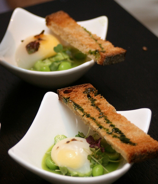 Touts Petit Pois en Demi - Poached quail's egg on green pea gelee, creamed green pea puree, and green pea with mustard cress salad, served with toast and basil oil