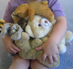 close-up of the armload of stuffed animals