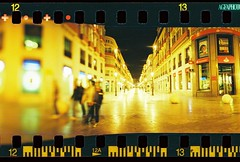 blurry night crawl (golfpunkgirl) Tags: travel film night 35mm lights spain holidays horizon malaga panaramic agfavista200 horizonperfekt 120 exposedsprockets