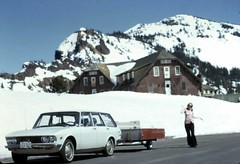 1969 Mazda 1500 Station Wagon and Tent trailer at Crater Lake Oregon Easter 1973 (D70) Tags: mazda 1500 station wagon tent trailer crater lake ore easter 1973 tenttrailer lodge teenager snow mountain volcanic 50–90mmf35 usa 1969 oregon olympus penf slr half frame film slide scanned following an agreement signed with bertone april 1962 1965 luce show car was beautiful sedan designed by giorgetto giugiaro italy