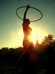 johanna is building her hooping-skills (jenny-alice) Tags: sunset woman girl silhouette hoop lensflare flare hooping sunflare
