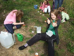 Children making plaster casts of animal tracks near to the trackbed during the previous session