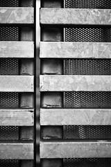 Lockdown (belleshaw) Tags: door blackandwhite metal bars downtown bokeh gap locked sandiegoca 50mmf18 gaslampquarter