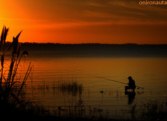 Screams of Silence - Lonely Fisherman Under the Setting Sun (Onironauta...) Tags: sunset portrait orange lake argentina backlight canon contraluz atardecer fire interestingness twilight fishing fisherman buenosaires nikon heaven alone smoking explore solo getty lonely redsky soledad fuego crepusculo pescador lonelyness pescando cielorojo chascomus explored abigfave onironauta