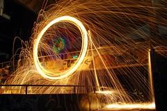 Eric On His Magic Stick (Burnt Umber) Tags: light party urban lightpainting building art abandoned night concrete graffiti fireworks tag explorer illumination orb celebration fluorescent vandal vandalism spraypaint 4thofjuly sparks tagging ue urbex steelwool sktline allrightsreserved miamimarinestadium flurbex lightartperformancephotography rpilla001