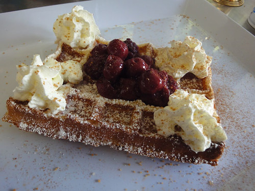 Waffle with cherry compote and whipped cream