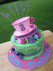 Different angle (Christina's Dessertery) Tags: birthday pink blue 3 green girl cake sparkles three leaf purple chocolate alice cream butterflies sugar lilac butter bow ribbon teacup wonderland wonky edible madhatter whimsical sculpted topsyturvy fondant buttercream gumpaste fivepetalflower funkyletters teacupcake ribbonleaves ribbinroses creativecakedesigns