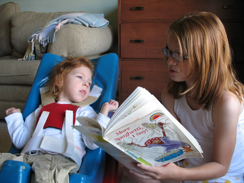 Emma reads to Hanna