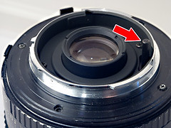 On Rokkor lenses with an Automatic Diaphragm, you will find a cylindrical post that stops down the lens during an exposure. This is an easy way to identify Rokkor lenses.