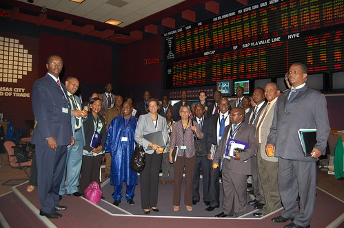 The African ministers of commerce, trade, and agriculture on the trading floor of the Kansas City Board of Trade.