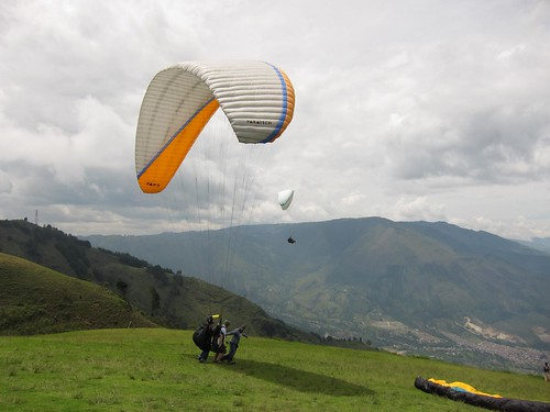 Drew takes off on his first paragliding flight.