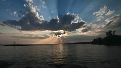 Sunburst-On Lake Nipissing (CUCKOOPHOTHOG) Tags: camera sunset ontario canada lens landscape rocks photographer country lakes places beaches filters province northbay canadianshield nikond300 tokinaatx116 ruiferreira hoyalpfpolarizercir